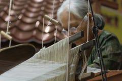 Free Weave Of Making Thai Silk Stock Image - 65723311