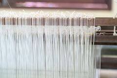 Weave silk cotton on the manual wood loom Stock Photography