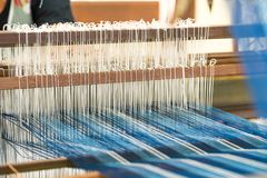 Weave silk cotton on the manual wood loom. In Thailand ,The process of silk weaving in the production of Thai silk royalty free stock photography