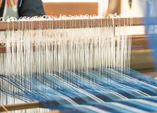 Weave silk cotton on the manual wood loom. In Thailand ,The process of silk weaving in the production of Thai silk stock images