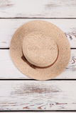 Weave summer hat, top view. Vertical image of beige straw panama on retro wooden background Royalty Free Stock Images