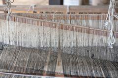 Weave and Thai silk. activity involving skill. In making things by hand stock photos