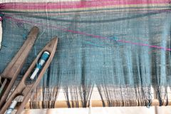 Weave and Thai silk. activity involving skill. In making things by hand stock photo