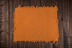 Weave on the wood. A orange color weave on the wood Stock Photography