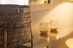 Weaved basket with candles in home concept