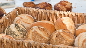 Weaved basket of local, fresh baked variety of hot roles Royalty Free Stock Photos