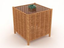 Weaved table with a green ashtray Royalty Free Stock Images
