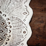 Weaved tablecloth on brown background Stock Photography
