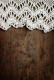 Weaved tablecloth on wooden background Stock Images