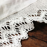 Weaved tablecloth on wooden background Stock Photo