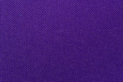 Weaved textile background. On violet base Stock Photo