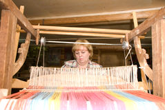 Weaver. At the old loom Stock Images