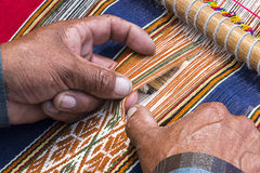 Weaver Peru weaving. Peruan weaver weaves traditional peruan carpet Royalty Free Stock Images
