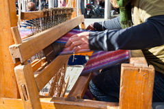 Weaver weaves a cloth Royalty Free Stock Photography