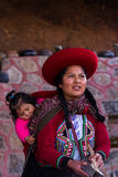 Weaver woman with her baby in Chinchero Royalty Free Stock Images