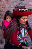 Weaver woman with her baby in Chinchero Stock Image