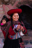 Weaver woman with her baby in Chinchero Royalty Free Stock Photos