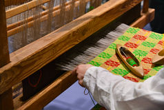 Weaver at work on loom Stock Image