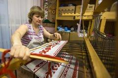 Weaver while working in the Textile Studio of decorative art `Tekstilnaya Plastika`, at municipal budgetary institution of cultur. VAZHINY, LENINGRAD REGION Royalty Free Stock Photo