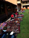 Weavers of Chinchero. The women weavers of the Chinchero Weaving Cooperative near Cusco, Peru, display their hand-woven textiles for sale Royalty Free Stock Photography