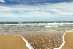 Wet sea shore in sunny beach Royalty Free Stock Image