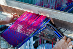 Weaves with an old loom handcraft rug Royalty Free Stock Photo