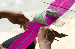 Weaving. A woman inside country national minority is weaving now royalty free stock photography
