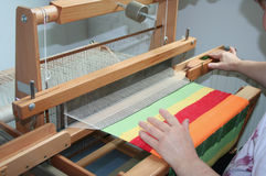 Weaving. Woman with syndrome Down does a fabric Stock Image