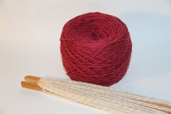 Weaving accessory and wool scarf Stock Photo