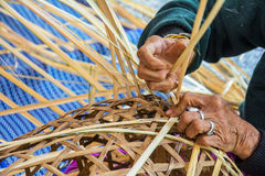 Weaving bamboo basket. Stock Image