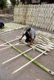 Weaving a bamboo mat Royalty Free Stock Image