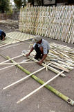 Weaving a bamboo mat Stock Photos