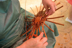 Weaving a basket Stock Photography
