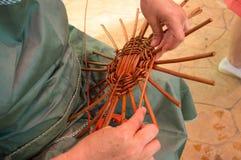 Weaving a basket Stock Photography