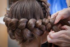 Weaving braids brunette Stock Photo