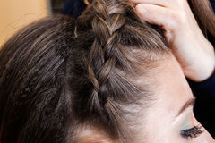 Haidresser braiding hair Royalty Free Stock Photo