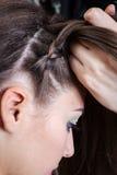 Weaving braids girl Royalty Free Stock Photo
