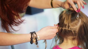 Weaving cornrows child stock video footage