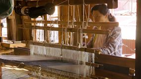 Weaving factory in Burma. A local woman has been fabric producing stock video