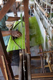 Weaving green silk fabric on loom Stock Images