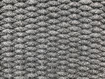 Weaving grey small tight cotton rolls as a pattern of wicker. Using for background stock photos
