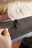 Weaving on handloom. A particular of a handloom stock photos