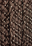 Weaving leather background texture. Lweaving leather and thread brown background texture Stock Image