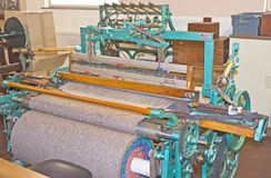Weaving loom at Edinburgh Woolen Mill. An image of a vintage weaving loom at Edinburgh Woolen Mill, Inverness Royalty Free Stock Photography