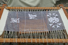 Weaving loom and embroidery Stock Images