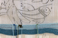 Weaving loom embroidery fabric Royalty Free Stock Images