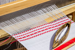 Weaving, loom with linen. Royalty Free Stock Photography