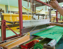 Weaving loom and shuttle on the warp Stock Photos