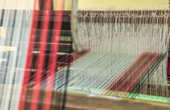 Weaving loom and shuttle on the warp Stock Images