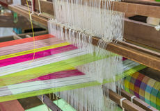 Weaving loom and shuttle on the warp Royalty Free Stock Photography